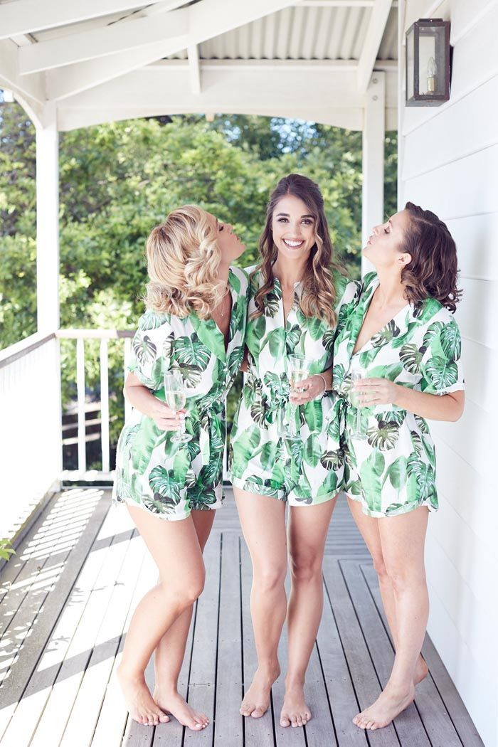 Tropical bridesmaids jumpsuits for getting ready. Credits in comment.
