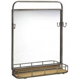 Un miroir grand angle entouré d'astucieuses patères et complété d'une petite étagère basse avec rebord. Idéal pour une salle de bain, à suspendre en surplomb de la desserte de la même gamme ou en miroir d'entrée.