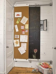 Rail panels hide a control panel with a cork panel and chalkboard panel
