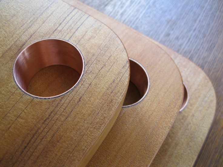 Solid Kauri Board with Copper Ring Detail | Felt