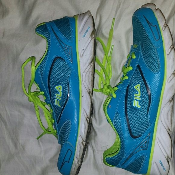 Fila Running Shoes Womens size 10. Worn a handful of times.  Roomy. DLS  Memory foam inserts. Fila Shoes Athletic Shoes