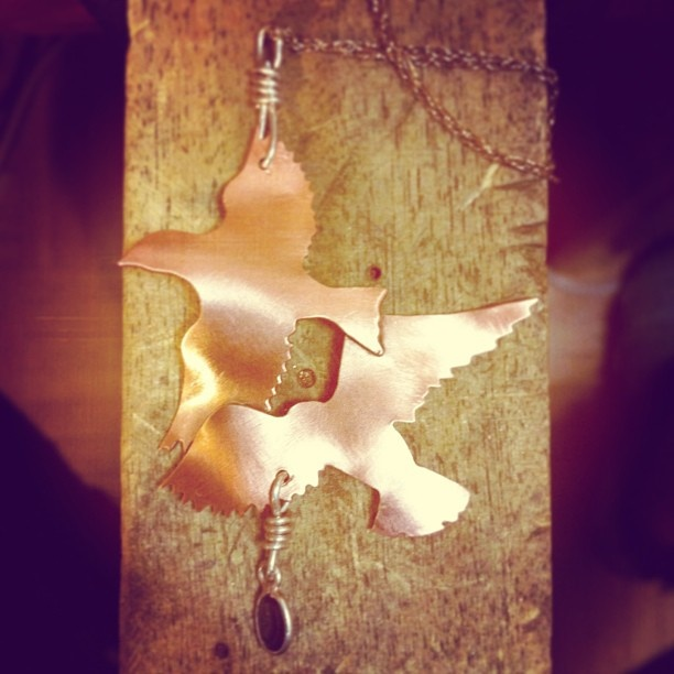 """Two Birds with One Stone"" pendant"