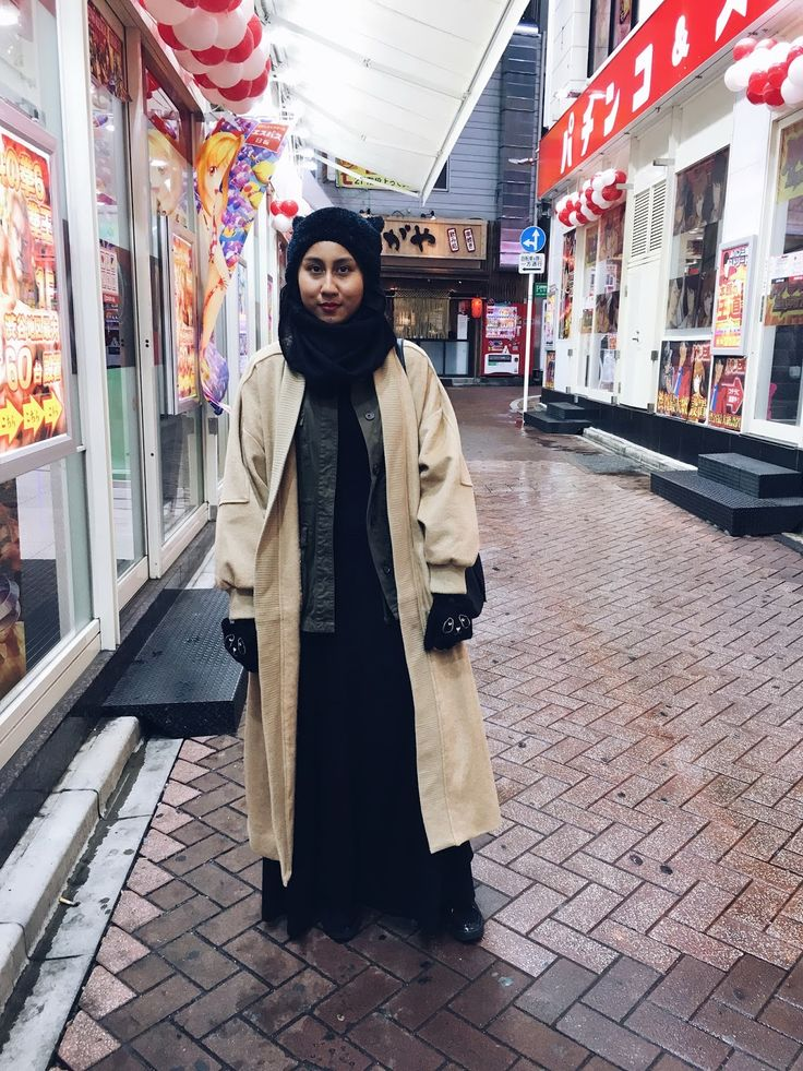 Cat ears beanie, long camel varsity jacket, layering jackets