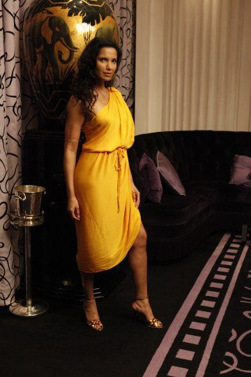 Draped fitted dress with a gold arm cuff. Love the color, too