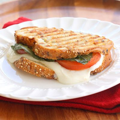 Grilled mozzarella, tomato, basil sandwich  would kill for this right now