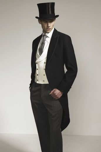 Old fashionedy looking morning suit with good trousers, DB waistcoat, 4 in hand tie and top had.