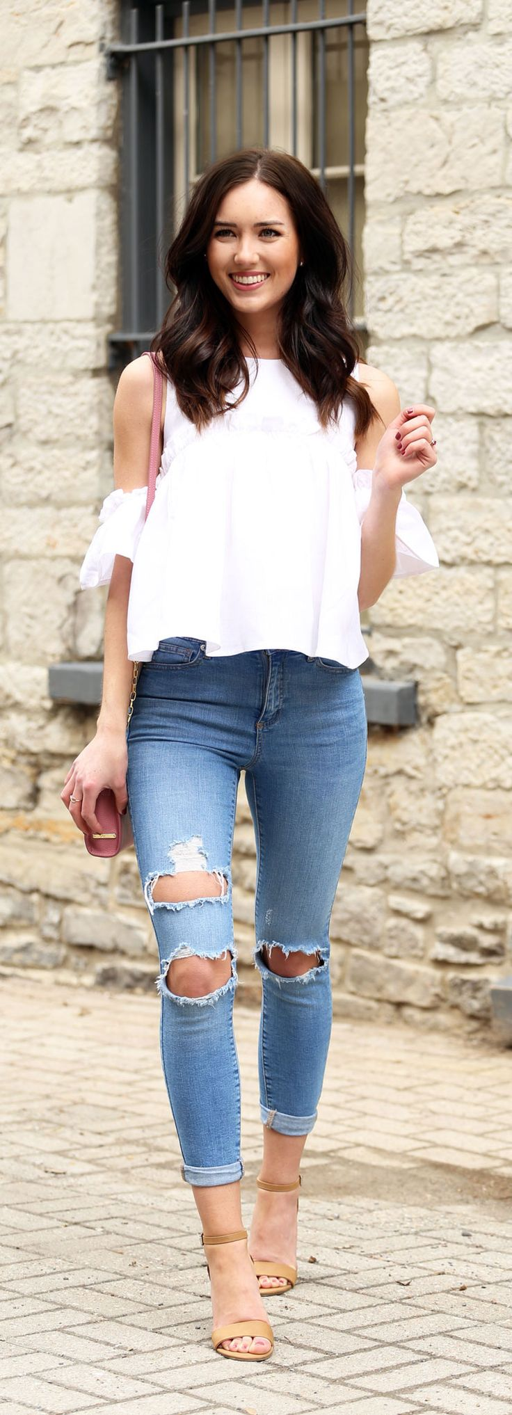 Cold shoulder ruffle white top paired with nude sandals and ripped skinny high waisted jeans (all affordable)
