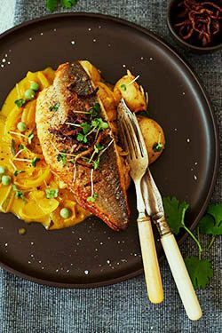 Sea bass with coconut curry There is an amazing story behind my Sea bass with coconut curry recipe which was influenced by my food hero Atul Kochhar. The coconut curry has a fresh delicate flavour that doesn't overpower the pan fried sea bass. I would say