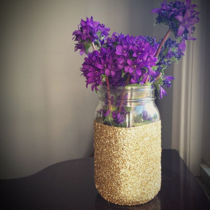 Mason jars are cute for any occasion. Stick this in a little space that needs something to complete your purple and gold nursery.