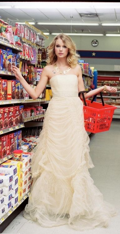 """Hi, I'm Taylor Swift, and yes, this is my everyday shopping outfit. Who doesn't wear a prom dress to the grocery store?"""