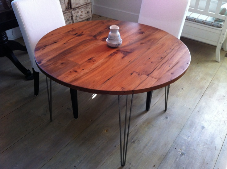 Modern industrial round dining table, cafe table or bistro table featuring reclaimed barnwood top with hairpin legs.