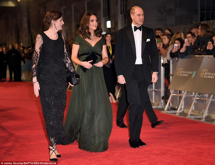 Bucking the trend: The Duchess of Cambridge (centre) chose not to wear black at Sunday nig...