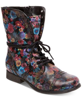 Steve Madden Women's Troopa Floral Combat Boots $79.98 Feminine florals bring vibrant color to rugged combat boot style in these Troopa boots from Steve Madden.
