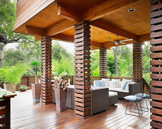love this so much. my garden seating place had that wooden deck, still dunno what to do around. that wooden column looks awesome
