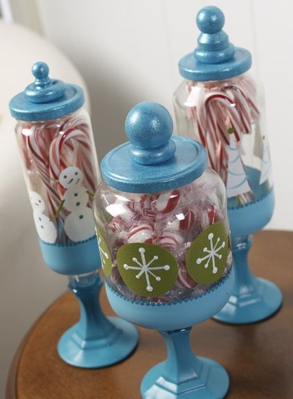 Love this! This is made from repurposed glass jars, 99cent store candlesticks wood finials glued to the lids of the jars (Mayonnaise, spaghetti sauce, etc..)