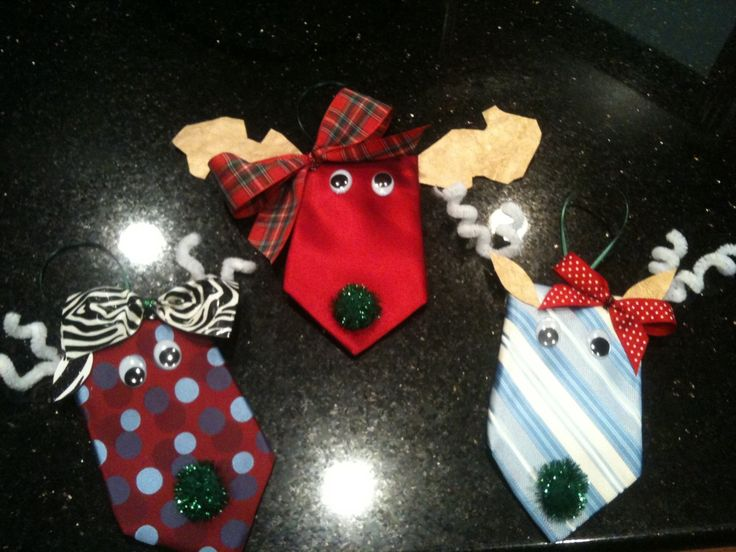 A friend shared this creative use for old neck ties and we made out own.  Adorable and simple.  We used heavy weight scrap book paper for the ear and antlers also used pipe cleaner as an antler option.  All assemble with a hot glue gun.