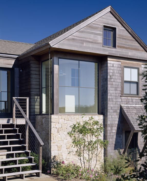 cedar shingles with cedar trim - and window wall juxtaposed with punched window.