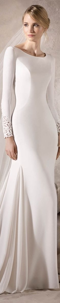 La Sposa Bridal 2017 Hailey Elegant mermaid wedding dress in crepe. Very classy, with a bateau neckline and long sleeves. It also has tulle details, embroidery and gemstones at the cuffs and on the back.