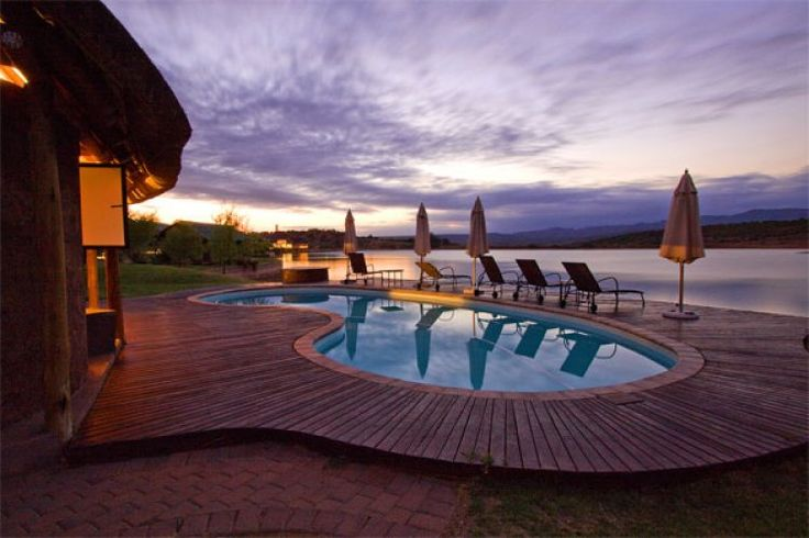 A pool, a view and an African sky at Buffelsdrift Game Lodge.