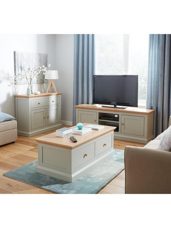 Hannah Corner TV Unit in Painted Sageand Oak-Effect - suitable for televisionsup to 44 inchOptional home assembly service available* This corner TV unit from the Hannah collection exudes country cottage elegance in an attractive two-tone finish.Slotting neatly into a corner of your living room, it's large enough to support flatscreen televisions up to 44 inch in screen size, as well as housing a range of peripherals on its open shelf.A painted sageframe is offset by a chunky top in con...