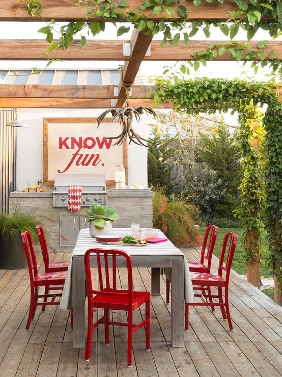outdoor dining table with red dining chairs deckpatio