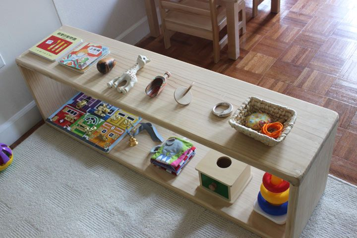 Montessori: Toy shelf for a 10 month old. 7 month old should have only 4-5 toys on it. Younger babies should have only 2-3 toys.