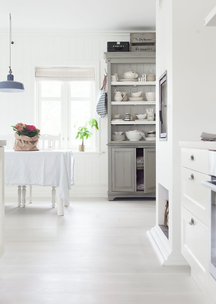 This painted cabinet is so amazing. I love gray painted pieces on a white background. How about you?