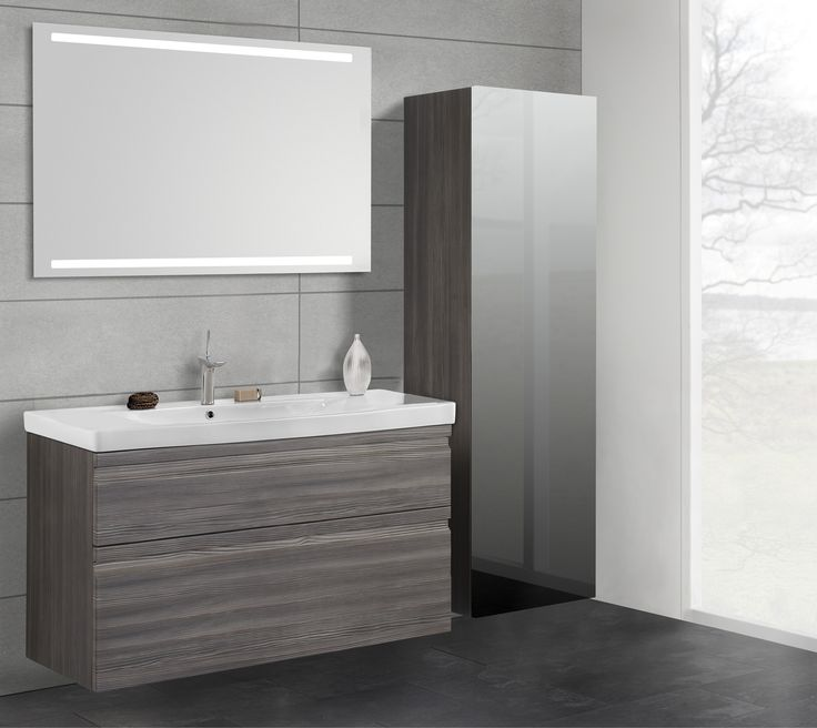 Mirror with integrated lighting provides great illumination where needed by lighting up both the basin below and wall above simultaneously.