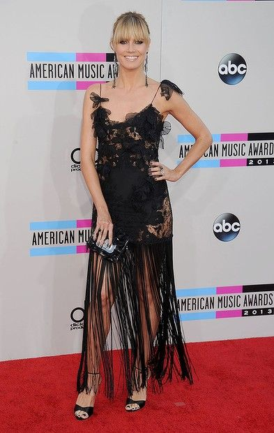 Supermodel/TV personality #HeidiKlum arrives at the 2013 American Music Awards at Nokia Theatre L.A. Live on November 24, 2013 in Los Angeles, California.