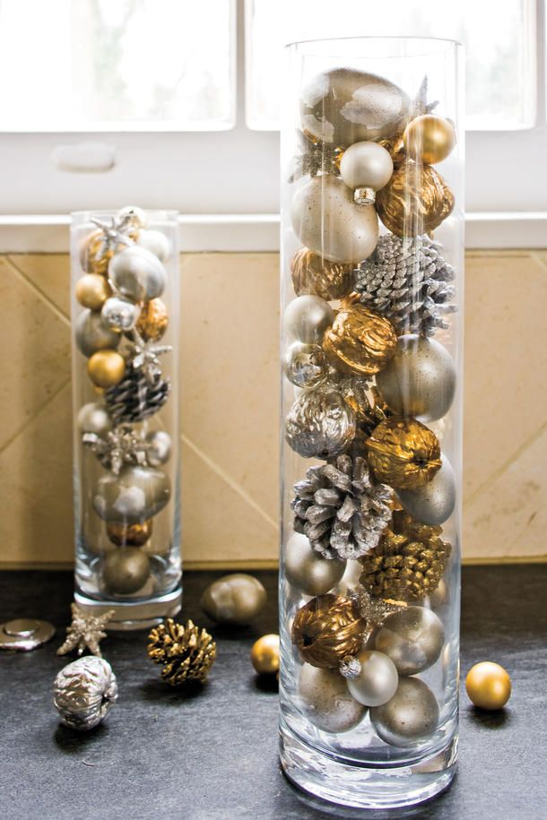 Use spray paint to add a shimmery touch to pinecones, acorns, or round glass ornaments. Displayed en masse in tall glass vases, they become instant and easy Christma
