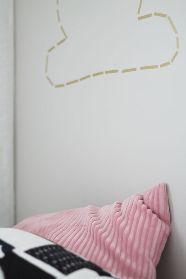 Golden cloud on a kidsroom wall made with masking tape.