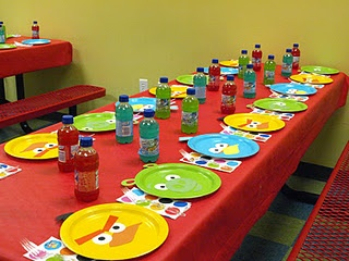 angry birds-party table...layer clear plastic plates over these...could let kids assemble the faces on plates as a start up activity? (Have samples for them to follow to do their favorite bird!)