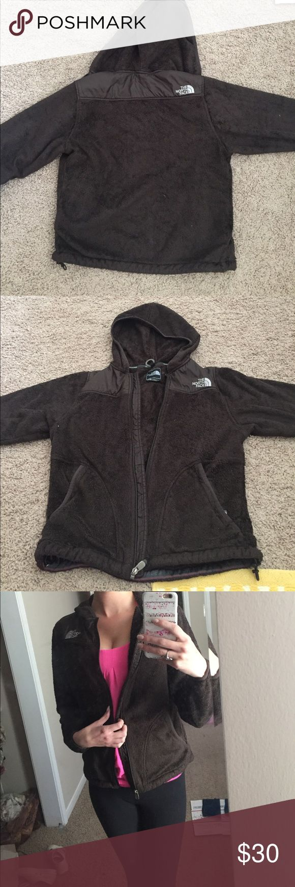 North face brown zip up hoodie This is a fabulous north face coat. It is warm and soft and in fairly good condition. The fur looks worn, but there are no stains or damage. North Face Jackets & Coats
