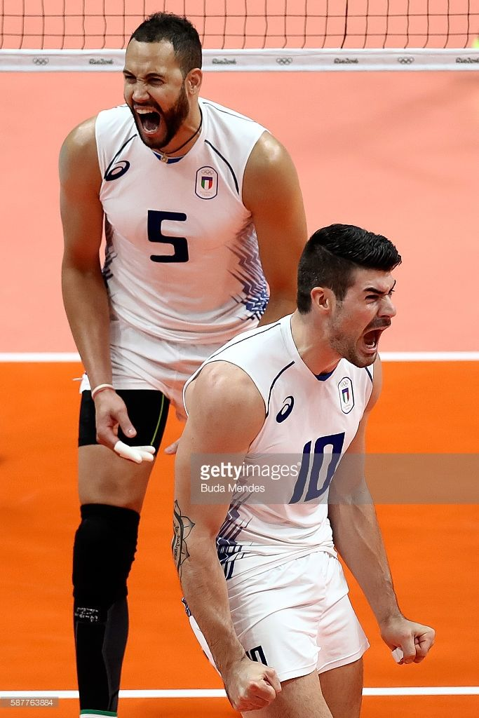 Osmany Juantorena #5 and Fillipo Lanza of Italy celebrate a point during the men's qualifying volleyball match between the United States and Italy on Day 4 of the Rio 2016 Olympic Games at the Maracanazinho on August 9, 2016 in Rio de Janeiro, Brazil.