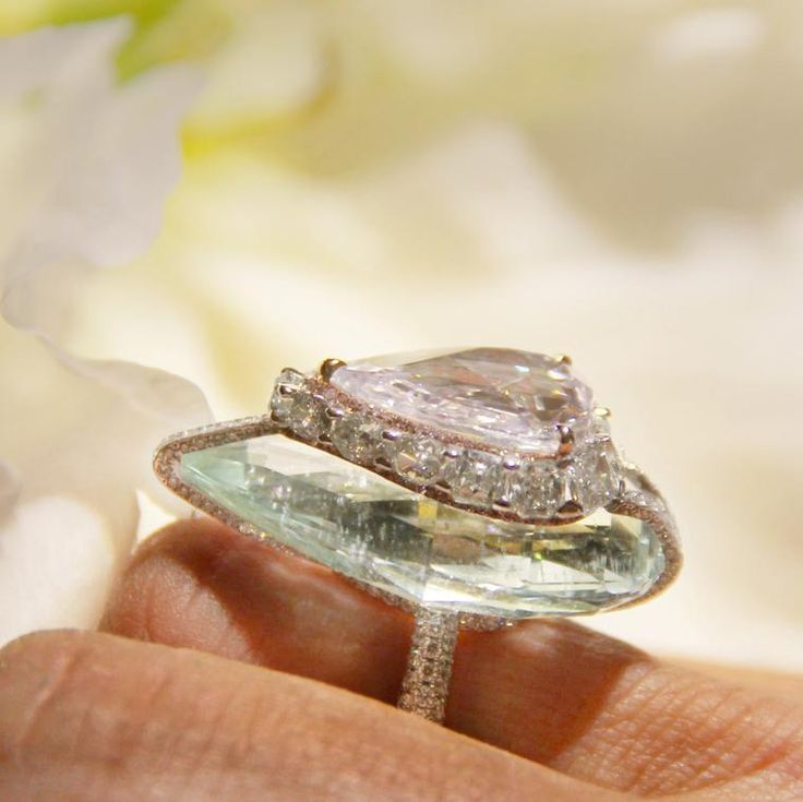 Purplish pink diamond and green beryl high jewellery Kissing Diamonds ring by Boghossian with diamonds set in white gold. http://www.thejewelleryeditor.com/jewellery/article/boghossians-daring-creations-are-perfect-reason-visit-masterpiece/ #jewelry