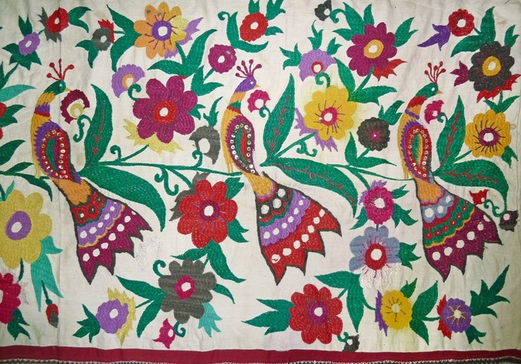 Detail from another Uzbek embroidered wall hanging found on ebay...love the colors!