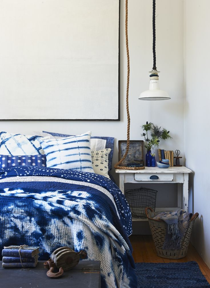 Dot duvet, $250 (Queen), The Bay. Throw blanket (On bed), spool, prices on request, Latre Art + Style. Throw blanket (in bucket), $199, blue pillowcase, $36/set of 2, Zara Home. Blue vases, Wire basket, geometric pillow, stylist's own. Pillowcase (for dyeing), $9, Ikea. Wood Handle, $2, Lee Valley. Rope, $20, Ropeshop.ca. Artwork, Ron Ackroyd