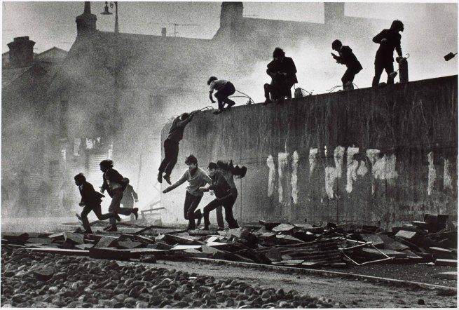 Don McCullin Catholic youth escaping a CS gas assault in the Bogside, Londonderry, Northern Ireland 1971