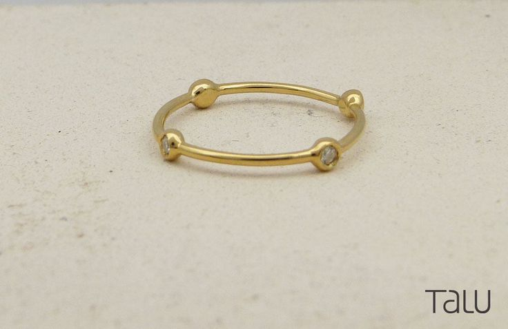 A personal favourite from my Etsy shop https://www.etsy.com/listing/524113593/tiny-diamonds-ring-14k-solid-gold