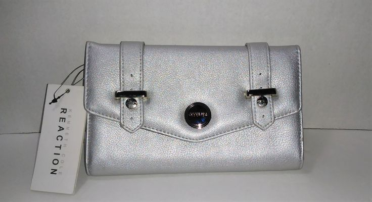 Our item of the day!  Kenneth Cole Silv... Check it out here: http://eden-online-boutique.com/products/kenneth-cole-silver-envelope-flap-clutch-tech-device-wallet-7-75-x-5?utm_campaign=social_autopilot&utm_source=pin&utm_medium=pin