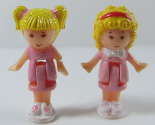 Polly Pocket! they're cuter then, when i was a kid, than now