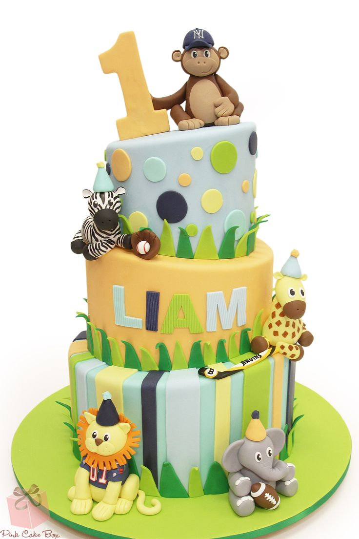 Always a popular first birthday cake option - animal theme!  These animals are all decked out with sporty outfits and gear!  Happy First Birthday Liam!