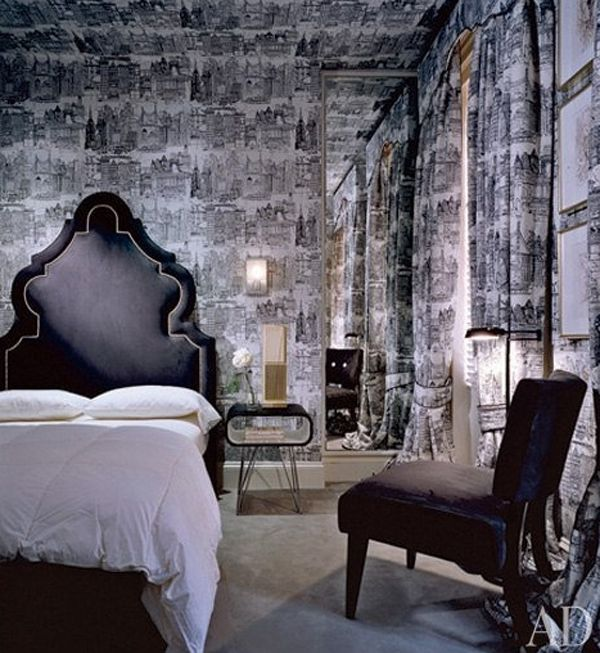Gothic bedroom with a 50s twist and crazy black and white city wallpaper