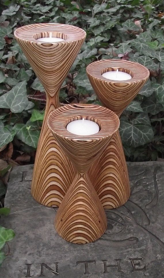 SALE - List price reflects the sale price  Original price = $99.95  Sale Price = $75.00    This tea light candle holder trio would make an artistic and functional statement piece in any room. These holders were hand turned from layers of laminated Baltic Birch. The wood has wonderful color variations and a beautiful prominent pattern with a modern vibe. Depending on how you display the holders, they can showcase a circular pattern or straight lines.    Each candle holder is finished...
