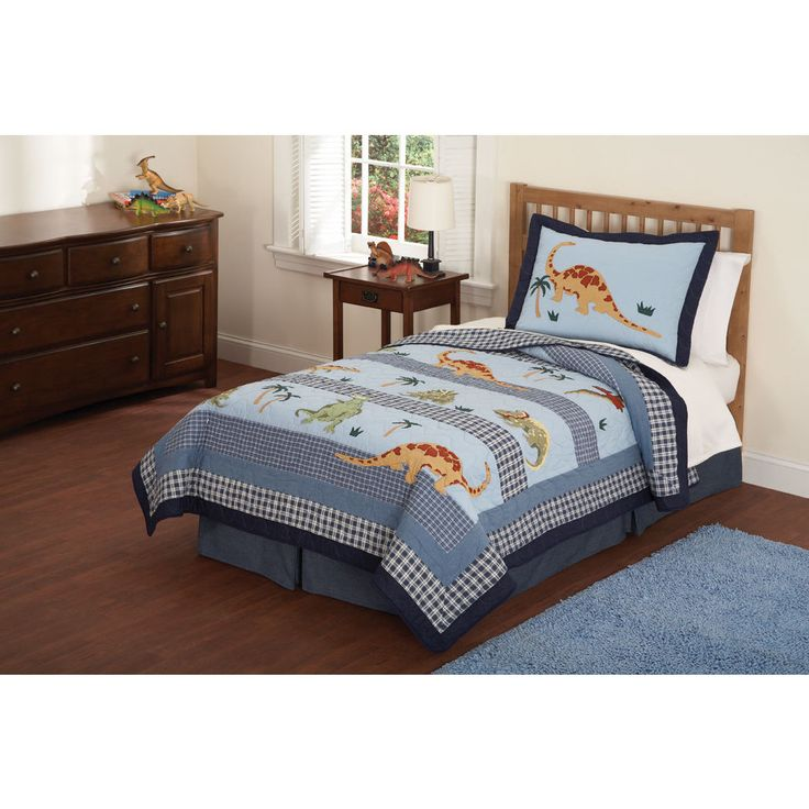 Dress your child's bed with the adorable Dino Dave quilt set including shams to complete the look. This cotton set features dinosaur patterns in a multicolored finish.