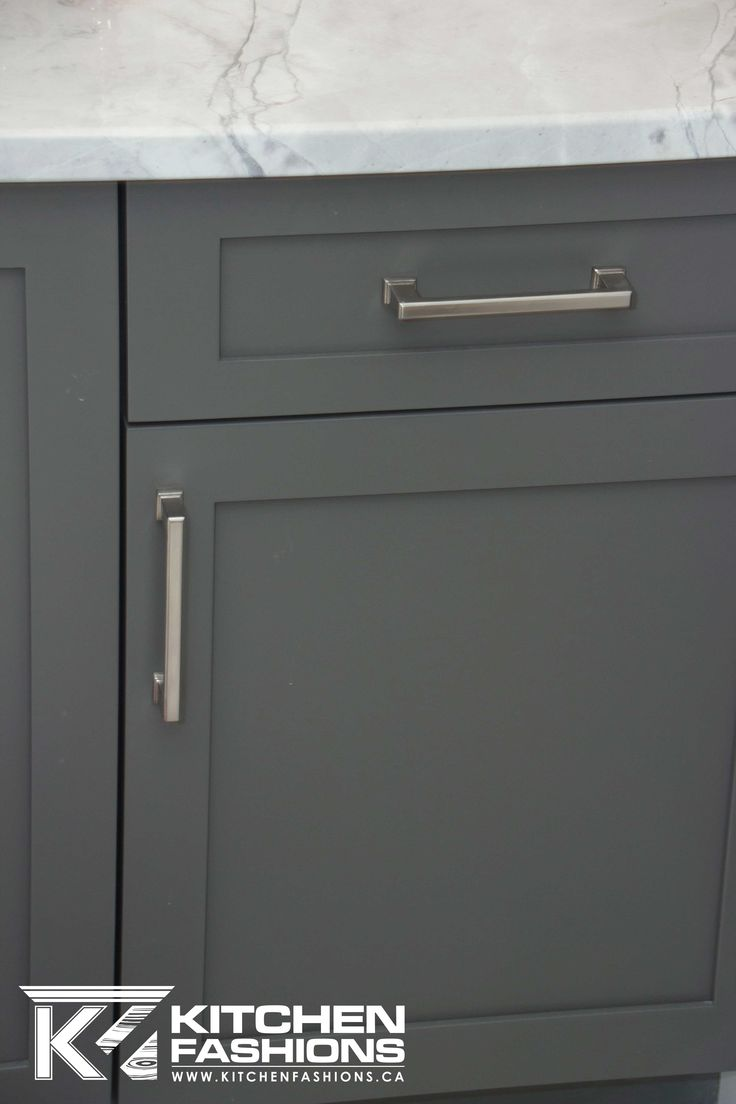 Silver square hardware pulls on gray cabinets