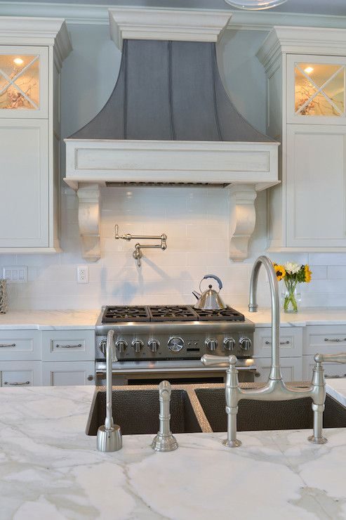 distressed gray French hood; statuary marble; large scale subway tiles
