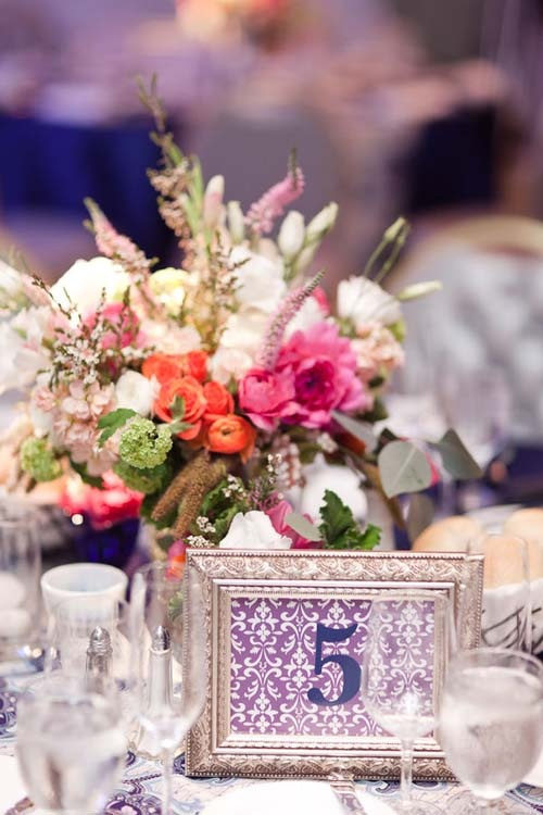 Picture frames as table numbers for a wedding or event.