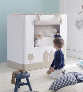 A puppet theater made from with art canvas.  Art canvas (3) can be purchased from Michaels, attached with hinges and a 3 sided window cut in center canvas.