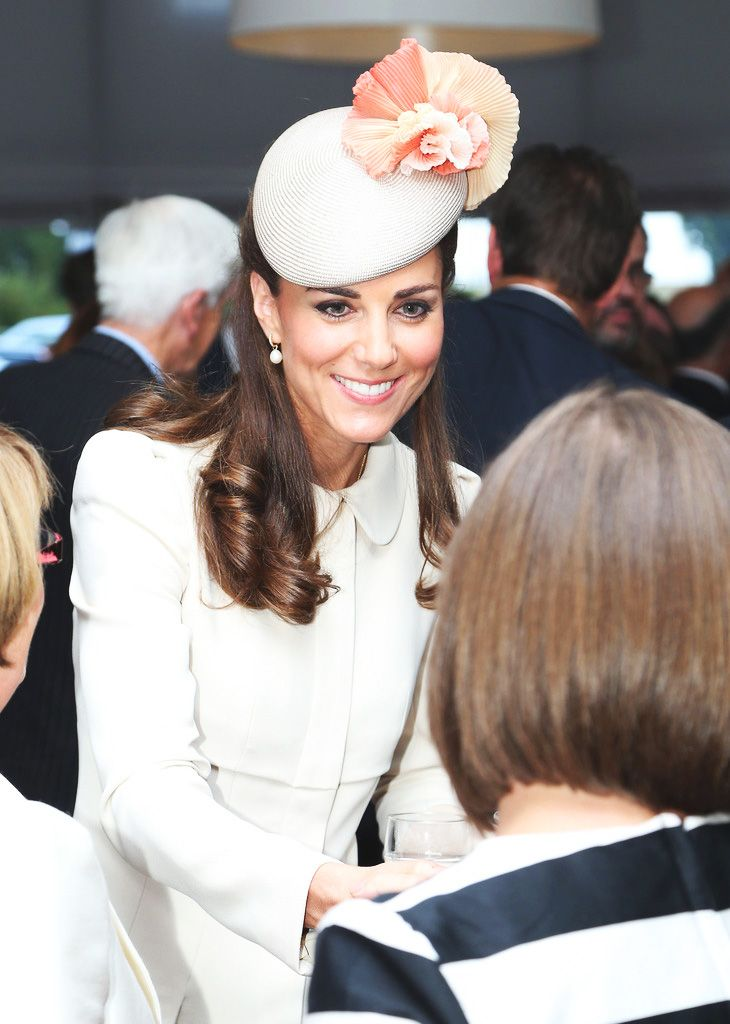 """royalwatcher: """" Catherine, Duchess of Cambridge speaks to guests after a ceremony at St Symphorien Military Cemetery on August 4, 2014 in Mons, Belgium. Monday 4th August marks the 100th Anniversary..."""